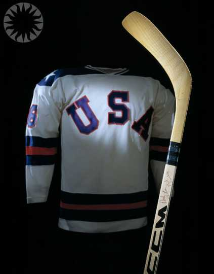 Color image of Bill Baker's 1980 Olympic jersey and hockey stick. Photographed on November 3, 2004, and shared via Flickr by public.resource.org.