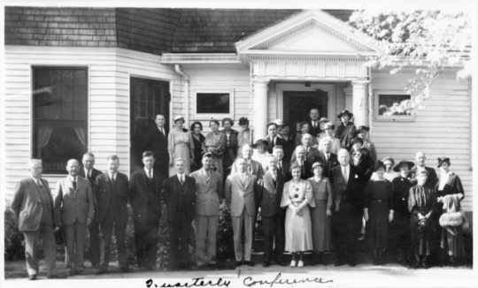 Members and staff of the Minnesota Board of Control in Faribault, 1936. Fourteenth from the left in the bottom row is Mildred Thomson.