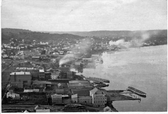 Late 1860s photograph showing barges along Red Wing's Mississippi River waterfront awaiting wheat for shipment to customers downriver.