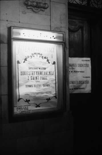Black and white photograph showing an advertisement for the SPCO's international debut during a tour of Poland, Czechoslovakia, Yugoslavia, and Romania in 1974.
