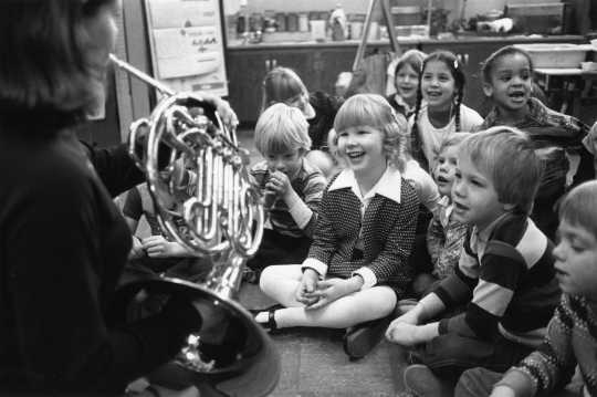 Black and white photograph of the SPCO's traveling wind ensemble at Saint Paul's Pratt Elementary School, 1976.