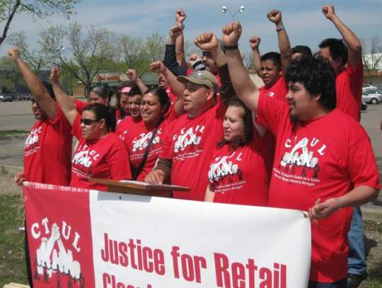 Members of the Centro de Trabajadores Unidos en la Lucha (Center of Workers United in Struggle, CTUL) rally to support retail cleaning workers and their legal fight to collect unpaid wages from big-box employers like Target and K-Mart, 2014. Used with the permission of CTUL; photographer unknown.