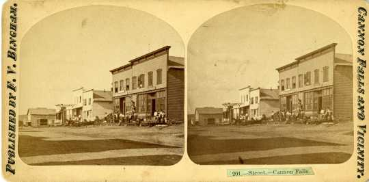 Stereoscopic card of business buildings in Cannon Falls, c. 1880s.