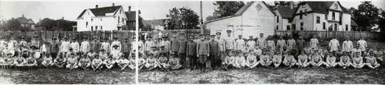 Black and white photograph of members of the Sixteenth Battalion of the Minnesota Home Guard, c.1918. After petitioning the governor, African American citizens formed their own battalion in order to serve.