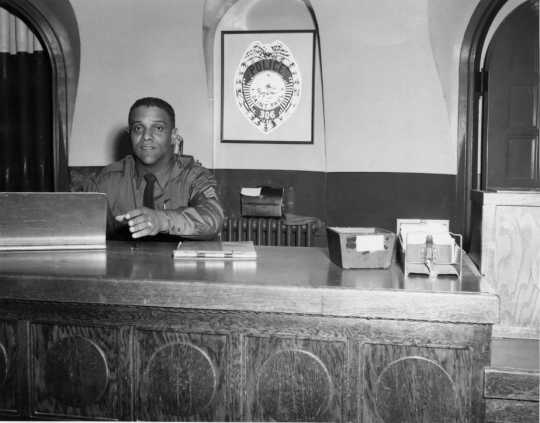 St. Paul Police Deputy James S. Griffin sitting at his desk, ca. 1960s. From box 1 of the James S. Griffin papers (P1679), Manuscripts Collection, Minnesota Historical Society.
