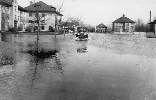 Black and white photograph of the flooded NWSA campus during the 1920s.