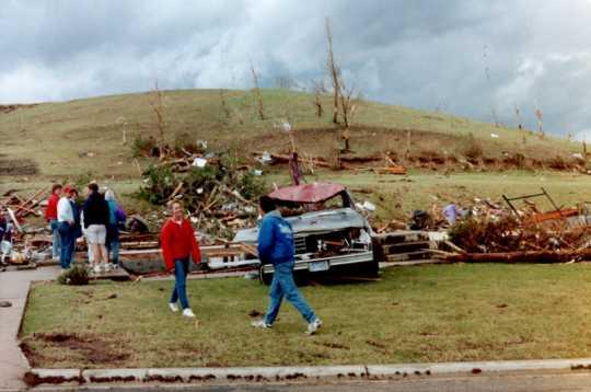 Survivors inspect property damage in Chandler after the Chandler–Lake Wilson Tornado, June 1992.