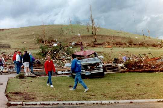 Survivors inspect property damage in Chandler after the Chandler–Lake Wilson Tornado, June 1992.
