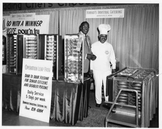 Restaurant trade-show booth for Howard's Industrial Catering, displaying patented heated food carriers and advertising the Operation Leap Frog feeding program, ca. 1960s. Oscar C. Howard papers, 1945–1990, Cafeteria and Industrial Catering Business, Manuscripts Collection, Minnesota Historical Society.