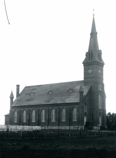 Black and white photograph of St. John the Baptist Catholic Church in Meire Grove, 1887.