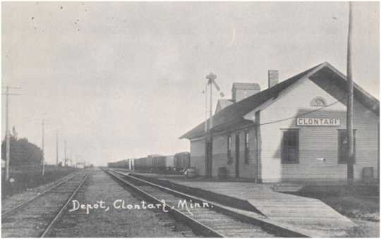 Black and white postcard showing the Great Northern Railway Depot and a grain elevator behind the depot in Clontarf, c.1880s.