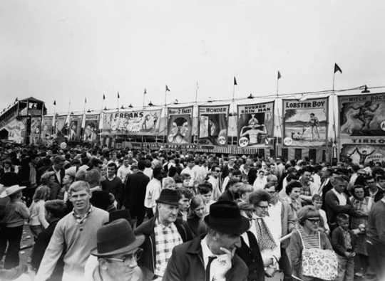 Black and white photograph of crowds at the Midway, Minnesota State Fair, 1963,