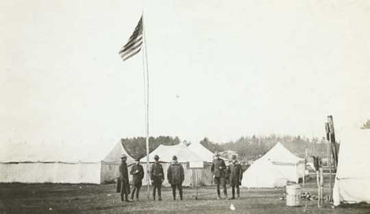 Black and white photograph of Minnesota Home Guard camp providing assistance after the fires, 1918.