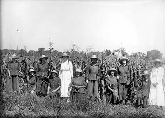 Incarcerated women posing by a cornfield