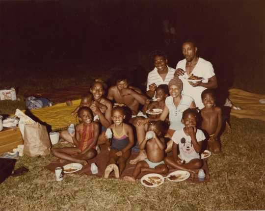 Color image of children and adults during a picnic. Photograph by Charles Chamblis, ca. 1985.