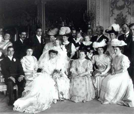 Black and white photograph of the Gertrude Hill–Michael Gavin wedding party in the James J. Hill House drawing room, 1906. Photographer: T.W. Ingersoll.