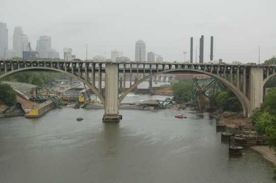 View of the I-35W bridge wreckage in the Mississippi looking through the arches of the  Tenth Avenue bridge in Minneapolis. Photograph by Kevin Rofidal (Edina Police Department), August 4, 2007.