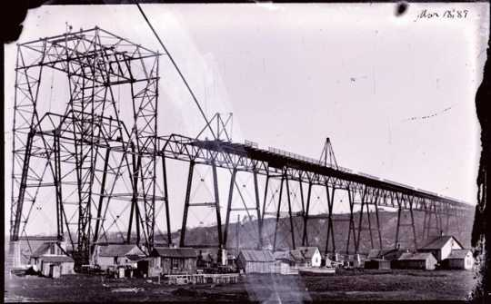 Black and white photoprint of high bridge construction c. March 1889
