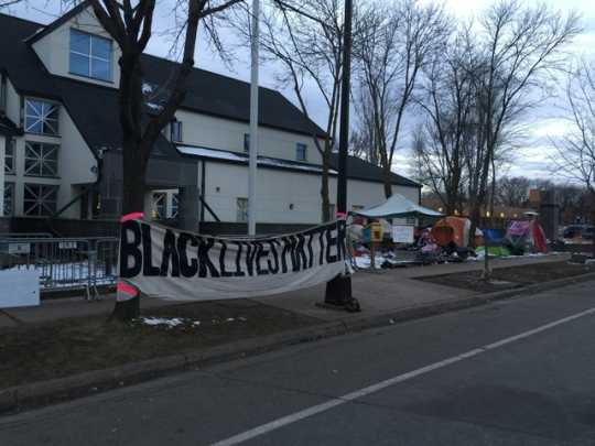 Black Lives Matter signs erected to protest the shooting of Jamar Clark on Plymouth Avenue in Near North Minneapolis (Fourth Precinct), November 2015. Photo by Rebecca Wright Gillette.