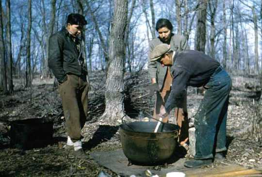 Maude Kegg (center) and family boiling maple sap