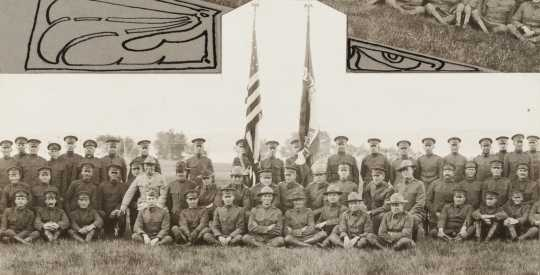 Black and white photograph of Minnesota Motor Corps officers and color guard at Camp Lakeview, Lake City, Minnesota, September, 1918. Motor Corps commander, Colonel Stephens, is kneeling left of the colors in the light colored tunic.