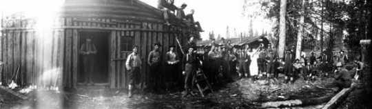 Black and white photograph of Lumberjacks in lumber camp, Rainy Lake & Virginia Lumber Company, ca. 1910.