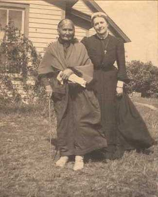 Black and white photograph of Sarah Good Thunder and Evangeline Whipple, ca. 1905.