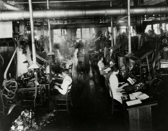Black and white photograph of typesetting with Linotype machines at West Publishing Company, 1917.