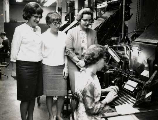 Black and white photograph of three West Publishing Company employees, c.1965.