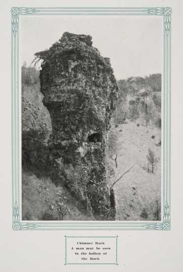 """Chimney Rock, Whitewater State Park, ca. 1917. Original caption: """"Chimney Rock: A Man May Be Seen in the Hollow of the Rock."""" From The Paradise of Minnesota: The Proposed Whitewater State Park (L. A. Warming, 1917)."""