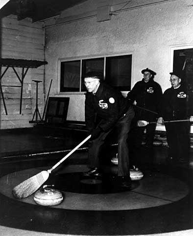 Action shot at the St. Paul Curling Club.