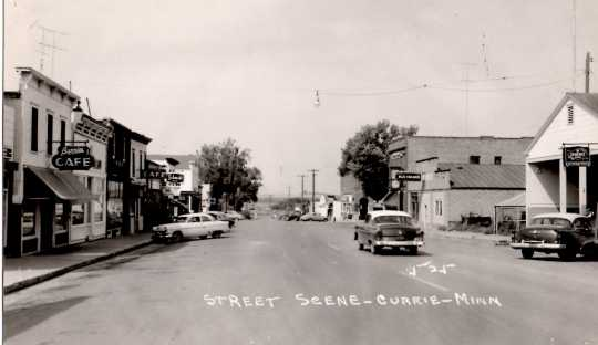 Black and white photograph of Main Street in Currie, 1956.