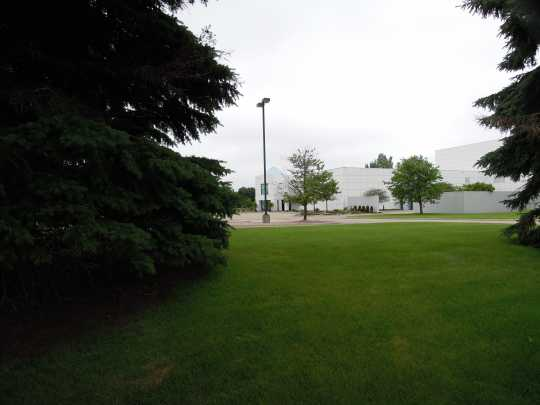 View of Paisley Park Studios with bushes in foreground