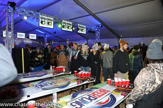 Beer pong competition at the International Eelpout Festival, 2017. A drinking game where team members tried to toss ping pong balls across the table into their competitor's cups of beer. If successful, the opponent would have to drink the beer in the cup. Photo by Josh Stokes.