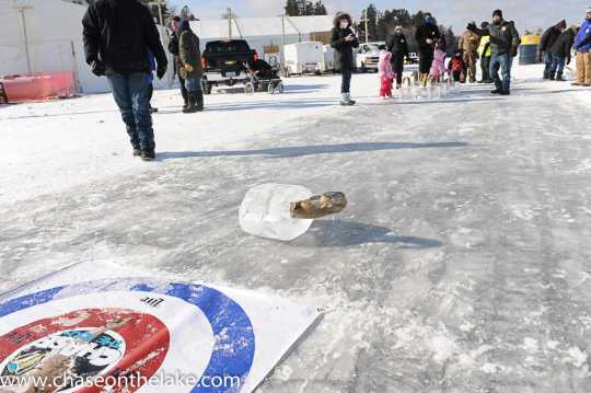 Eelpout curling competition at the International Eelpout Festival, 2015. Photo by Josh Stokes.