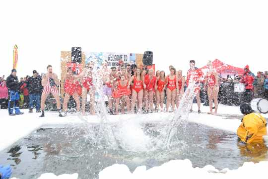 Hardy souls participating in the annual polar plunge event, International Eelpout Festival, ca. 2010s. Photo by Josh Stokes.