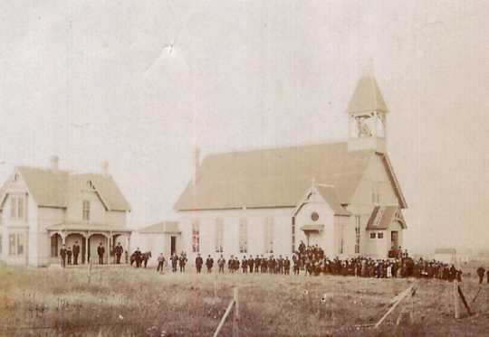 Black and white photograph of the dedication ceremony of the Immaculate Heart of Mary Catholic Church in Currie, held on September 23, 1883.