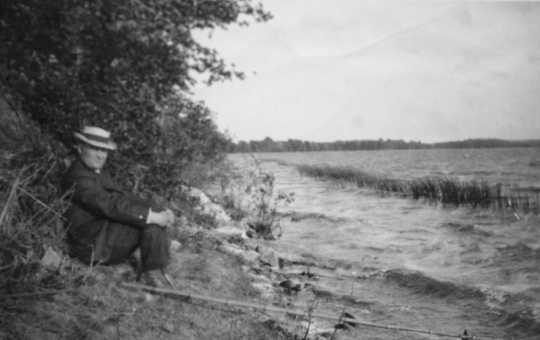 Black and white photograph of Dr. Henry Schmidt fishing, ca. 1918.