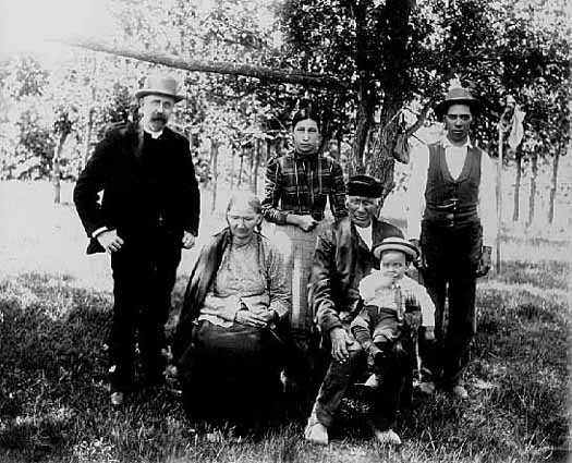 The Dakota leader Good Thunder (seated) and his family. Photographed at the Lower Sioux Dakota community in Redwood County c.1900.