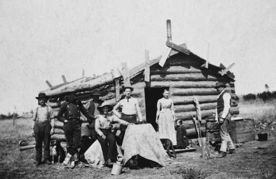 Swedish immigrants outside their cabin in Minnesota, ca. 1880.