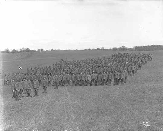 Black and white photograph of a full Battalion of Minnesota Home Guard at Glenwood Park, Minneapolis, 1918.