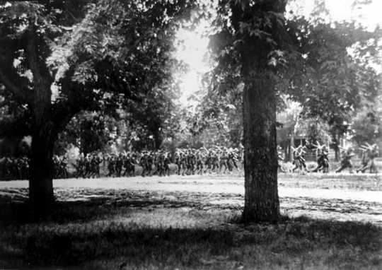 Black and white photograph of candidates marching in formation at the Officers' Training Camp, Fort Snelling, 1917.