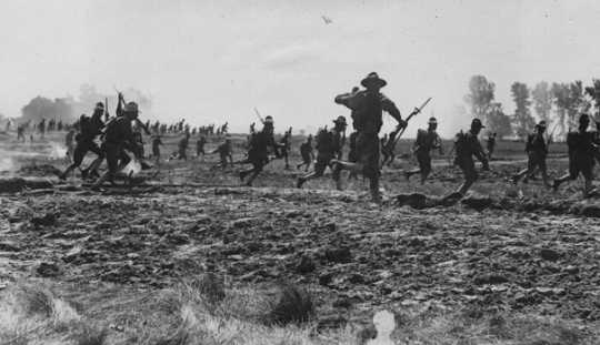 Black and white photograph of officer candidates advancing during military maneuvers, 1917.