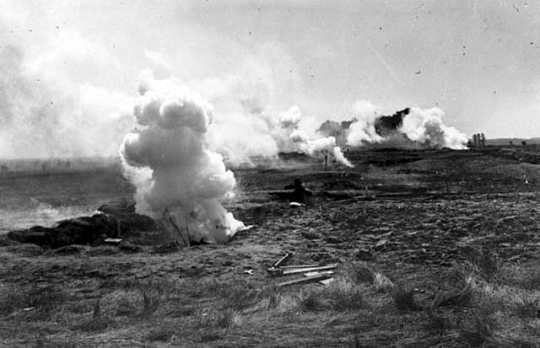 Black and white photograph of mock explosions during war maneuvers at the Officers' Training Camp, Fort Snelling, 1917.