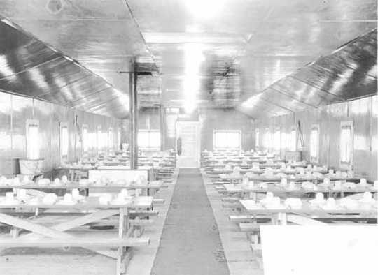 Black and white photograph of a camp dining hall, Company 707, Civilian Conservation Corps camp at Deer River, ca. 1936.