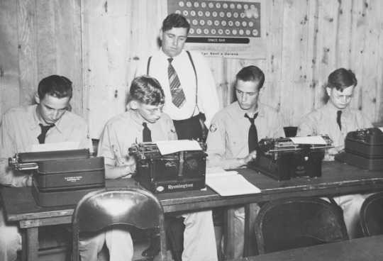 Black and white photograph of the Adult education program at the Civilian Conservation Corps camp at Maple Lake, ca. 1938.