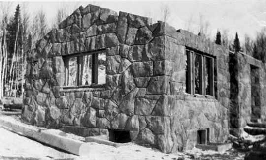 Black and white photograph of construction of a stone building by CCC Company 2710, Gooseberry Falls, ca. 1938.