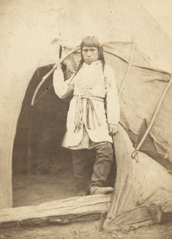 Black and white photograph of a Dakota boy at the concentration camp below Fort Snelling, 1863. Photograph by Whitney's Gallery.