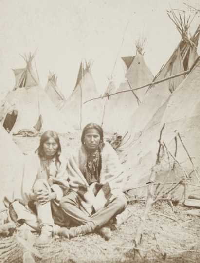Black and white photograph of wo Dakota men at the Fort Snelling concentration camp, c.1862–1863. Photograph by Benjamin Franklin Upton.