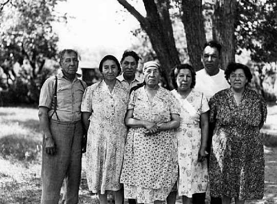 Relatives and friends of Solomon Wells (Tatanka Maza) and Mary Wells (Iha Ho Waste Win), Prairie Island. Minnesota, 1950.